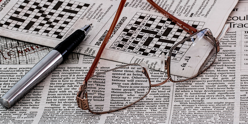 Image of newspaper and reading glasses