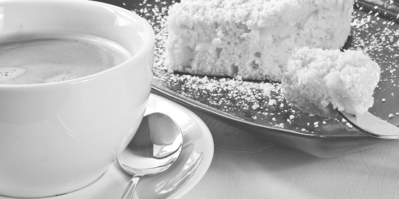 Image of coffee cup and slice of cake
