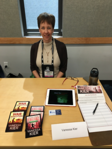 Vanessa Kier behind a sales table