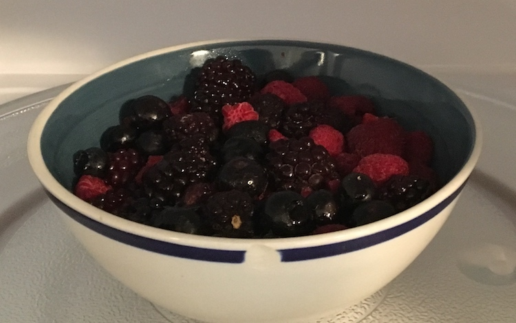 Photo of a bowl of thawed berries