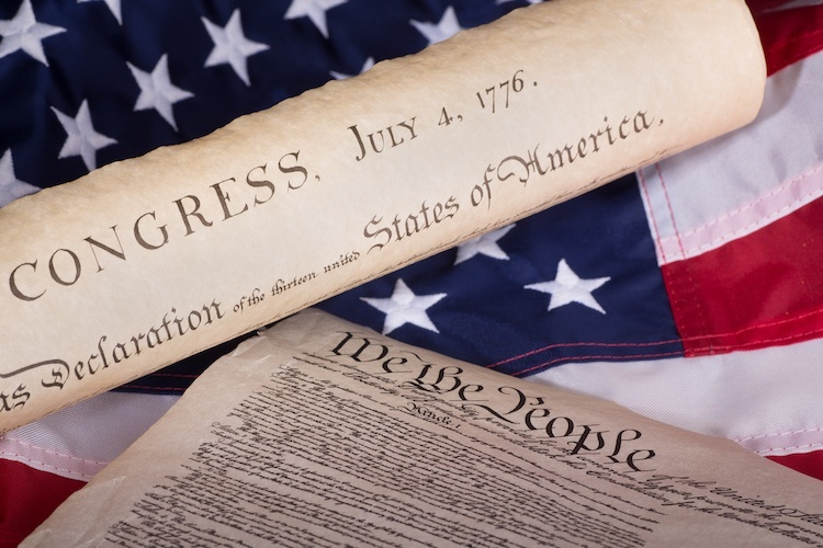 Partial image of American flag, US constitution, and Declaration of Independence