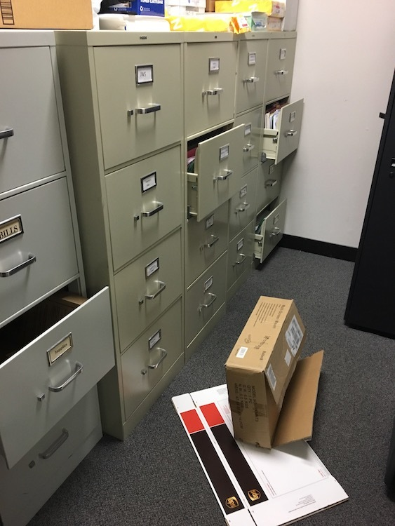 Photo of file drawers that opened because of an earthquake