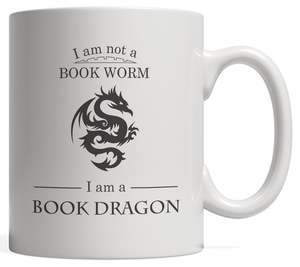White mug with black text and black image of a stylized dragon