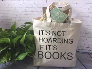 Photo of a tote bag next to a plant