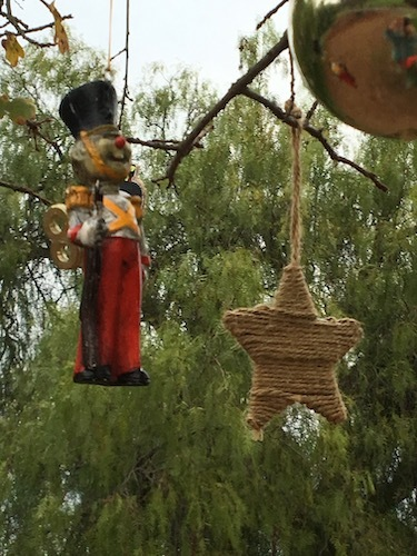 Photo of a wooden soldier at attention and a woven star
