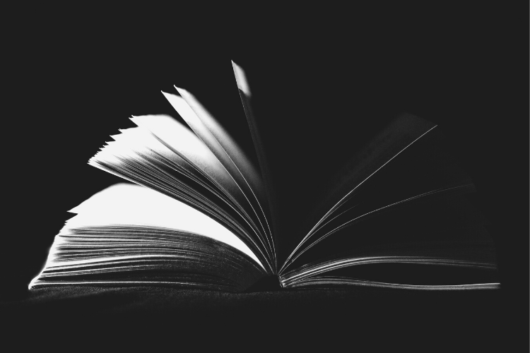 Image of an open book against a black background