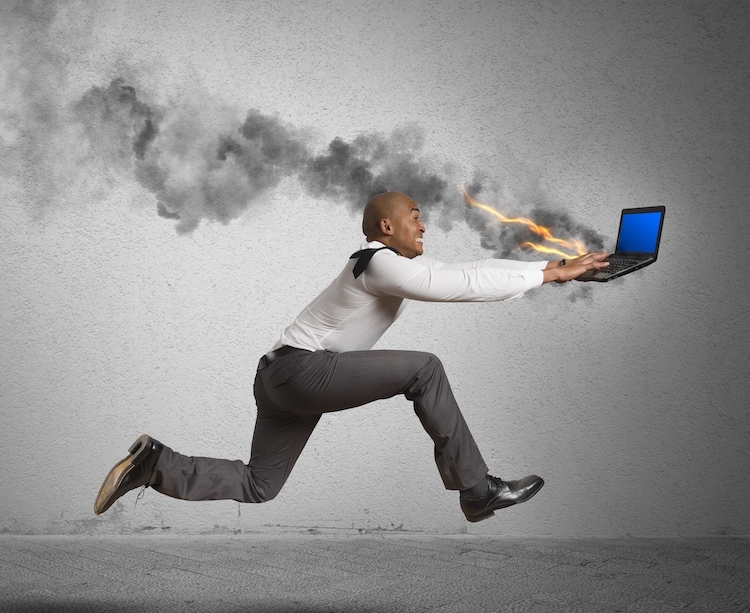 Photo of man running with burning laptop