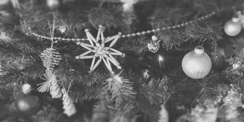 Black and white photo close up of ornaments on a Christmas tree
