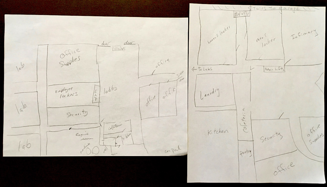 Photo of pencil drawings by Vanessa Kier of the original floor plan and the updated version for a building in one of her books.