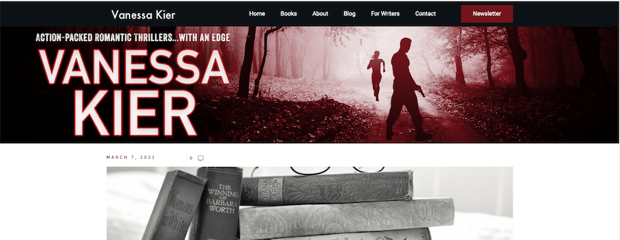 Screenshot of a black title bar with Vanessa Kier's name and the website's menu above a red, black and white photo of a path through the woods with a man and woman in silhouette and Vanessa Kier's name in large type.